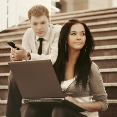 Young fashion business woman using laptop on steps