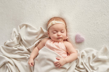 sleeping baby 3 months on a light background