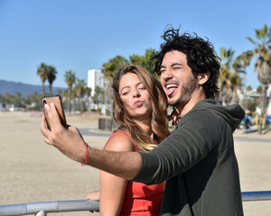 Young couple taking selfies on vacation