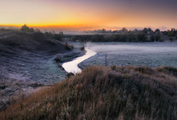 picturesque autumn dawn. foggy morning in the river valley