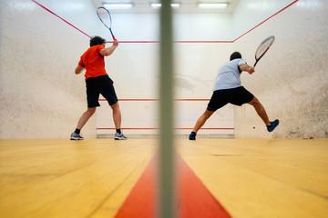 Two friends playing squash in Mutilva, Navarra, Spain