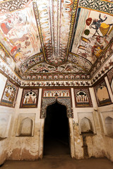 Exquisite ancient paintings on walls and ceilings in Laxminarayan Temple, built in 1662 in Orchha and dedicated to a Goddess Laxmi , India