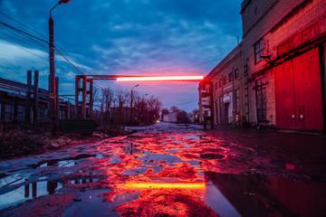 Autocollant pour porte Les vieux bâtiments abandonnés Old industrial area at night. Dirty pools on cracked asphalt of damaged road