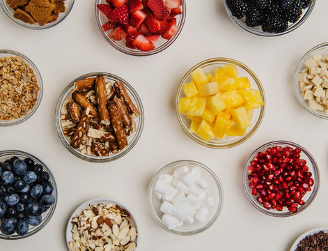 assorted dessert toppings of fruit, nuts and sweets