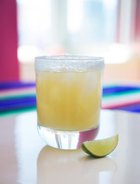 Margaritas on ice with salted rim