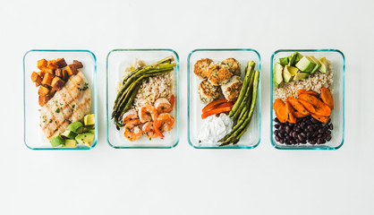 Meal prep containers filled with healthy lunches