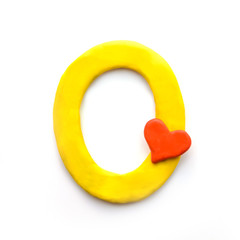 Plasticine letter O of the English alphabet