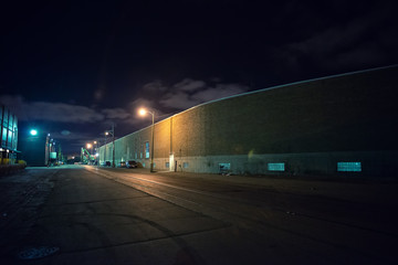Fotomurales - Industrial urban street city night scene with vintage factory warehouses and train tracks