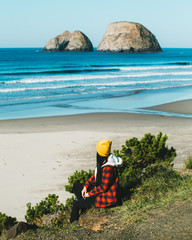 Girl Sitting On The Oregon Coast Near The Ocean