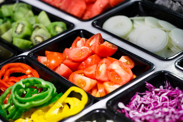 Fresh Vegetables and Fruits sliced in Salad Bar buffet