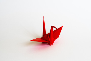 red Origami crane on white background