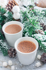 Foto op Canvas Chocolade two glasses with hot chocolate in Christmas decorations, selective focus