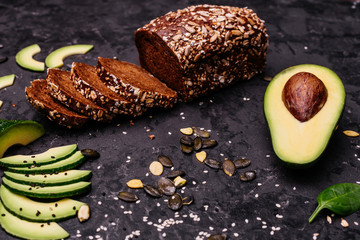 Food, avocado, healthy food. Avocado and brown bread. It can be used as a background