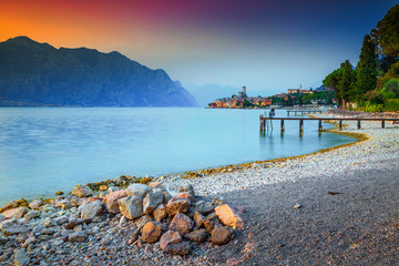 Wall Mural - Fabulous Malcesine tourist resort with colorful sunset, Garda lake, Italy