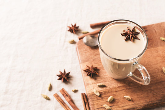 Mug of spice latter tea or coffee, winter and autumn hot drink