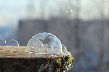Soap bubbles freeze in the cold. Winter soapy water freezes in the air.