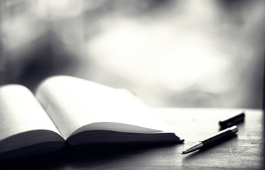open book and a table black and white