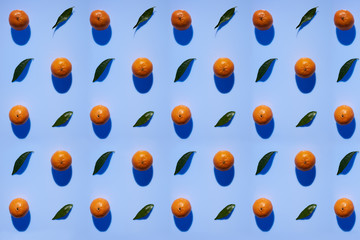 Tangerine pattern with leaves on a blue violet color background with vertical shadows in high resolution