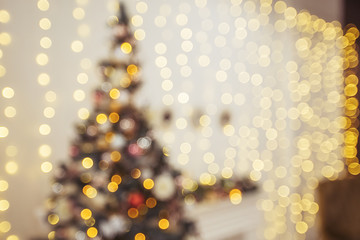 Christmas tree and holiday decorations. Blured defocused background