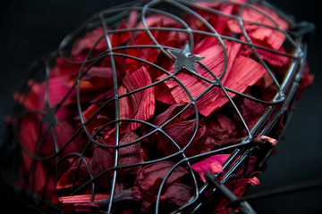 metal heart inside of rose petals
