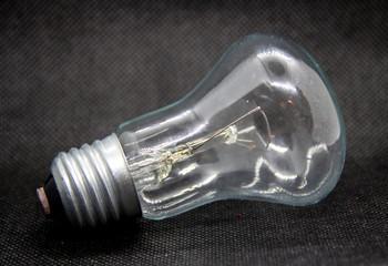 transparent light bulb on black background