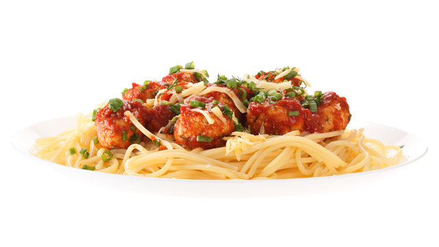 Spaghetti with meatballs with tomato sauce and cheese. Isolated on white background.