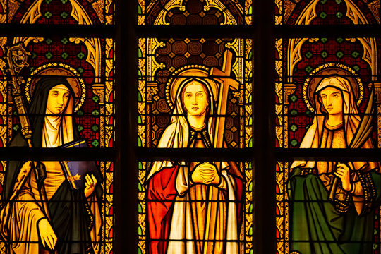 Details of a stained glass window at Notre Dame du Sablon Church in Brussels Belgium