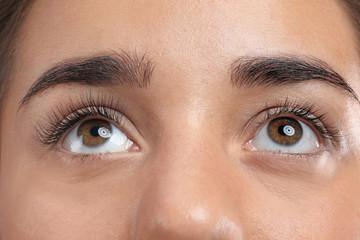 Young woman with beautiful eyelashes, closeup view