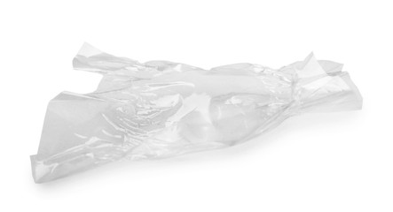 Crumpled transparent candy wrapper on white background
