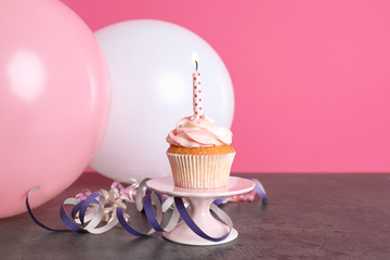Composition with birthday cupcake and balloons on table. Space for text
