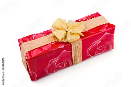Gift Box Wred In Red Rose Cellophane Decorated With Ecru Raffia Ribbon And Bow Isolated On The White Background