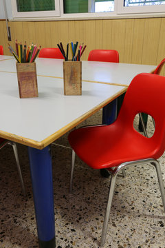 red chair in the class room of a school