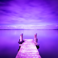 Wooden pier on the lake. Proton Purple