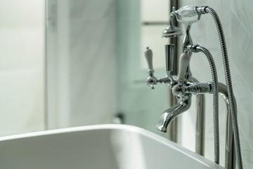 close up chrome faucet shower bath tub room  interior design