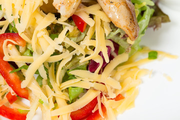Delicious salad with cheese and chicken fillet.