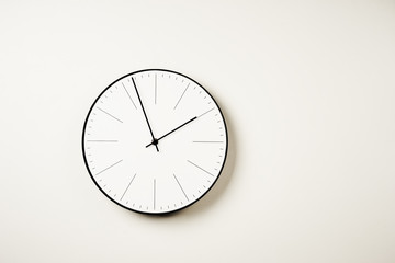 Classic round wall clock on a white background with copy space Fototapete