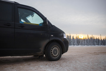 Minibus taxi standing at the crossroads in winter forest