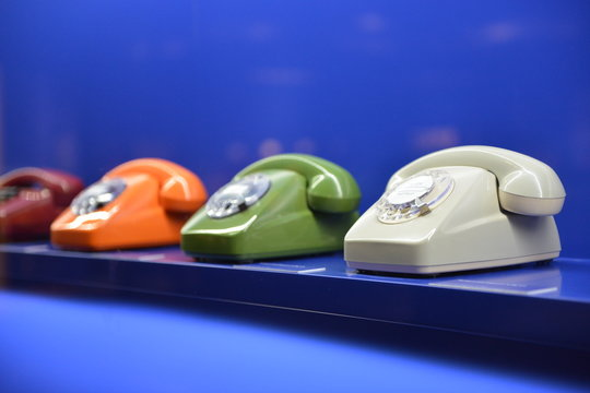Old-fashioned retro 1960`s phones on blue background