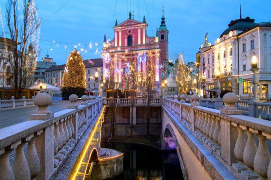 Triple bridges, Christmas tree on Preseren's square and Franciscan church, illuminated for Christmas and New Year's celebration, Ljubljana, Slovenia