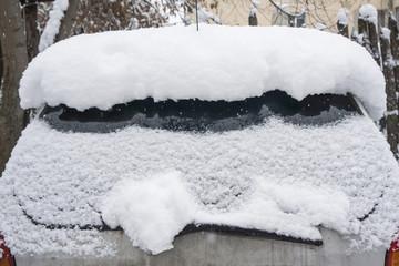 Winter frozen back car window, texture freezing ice glass background