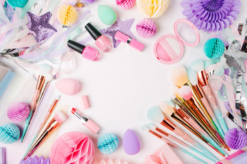 Makeup products and accessory with festive decorations. Flat lay. Beauty concept Wall mural