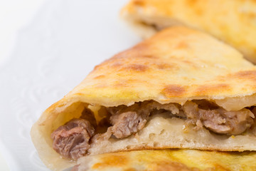 Delicious pie stuffed with lamb meat.