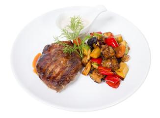 Grilled pork fillet with baked vegetables.
