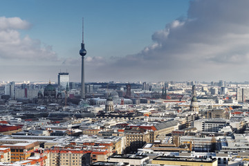Wide view over the sea of Berlin in winter with a striking cloud formation, TV tower as the main motif - Location: Germany, Berlin, Potsdamer Platz