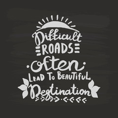 Difficult roads often lead to beautiful degtination handwriting monogram calligraphy. Black and white engraved ink art.