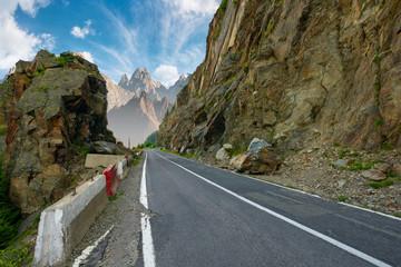 road in to the high mountains between rocky cliff. composite image of dangerous path to the dreams.