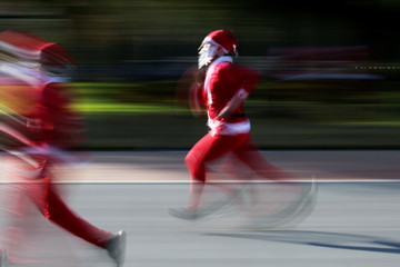 "Participants dressed as Santa Claus take part in the annual race known as ""Run Santa Run"" at Fundidora Park in Monterrey"