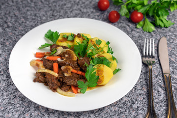 Roast meat with potatoes and carrots