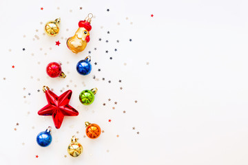 Christmas background with decorations. Shiny colorful balls, star and confetti. Flat lay, top view. Place for text.
