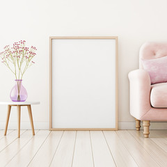 Poster mockup with vertical frame standing on floor in living room interior with pink sofa and flowers in vase. 3D rendering.
